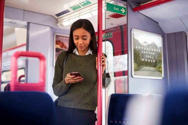 Woman using a mobile phone on a train